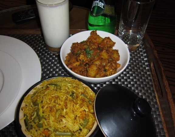 Aloo Gobi, Vegetable Biryani severed with a sweet lassi