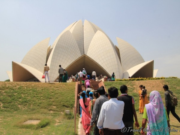 Waiting barefoot to enter the Lotus Temple