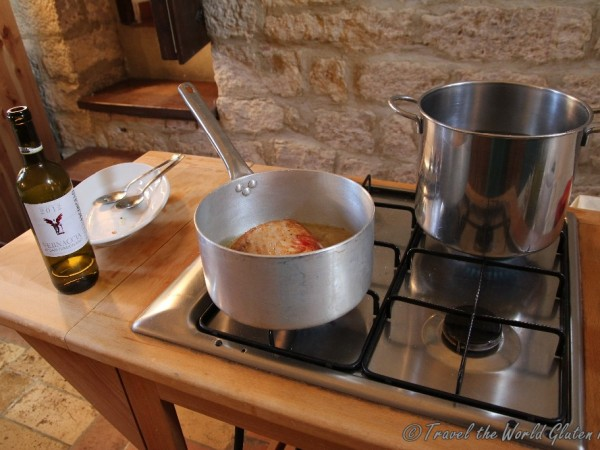 The pork and peperonata cooking on the stove top