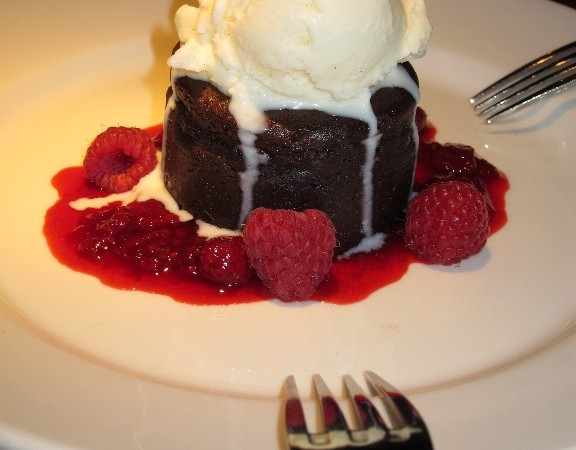Flourless chocolate cake with vanilla bean ice cream and raspberry sauce (before I was soy free)