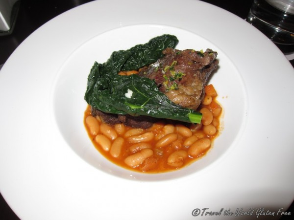 Sweet spiced braised beef cheeks with chili-sautéed winter greens and white bean ragoû