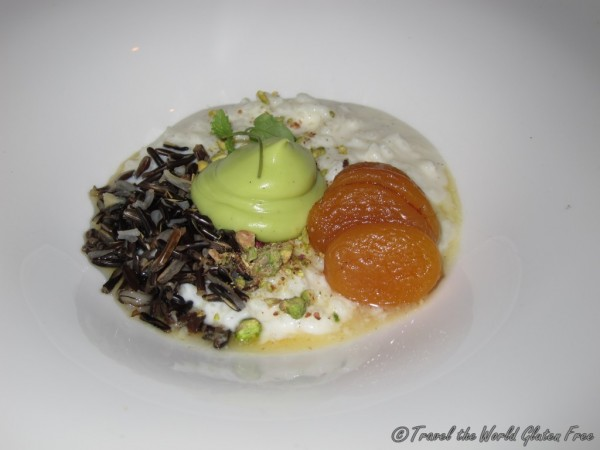 Wild Rice Pudding served with Poached Apricot, Rose Vanilla Sauce and Pistachio for desser
