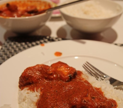 Butter Chicken – boneless pieces of chicken cooked with smooth tomato gravy and finished with butter and cream