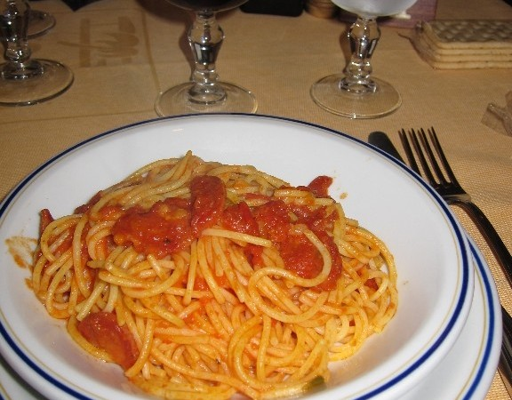 Gluten free spaghetti with tomato sauce and sausage
