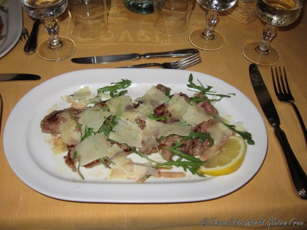 Tender veal with slices of Parmesan cheese and arugala